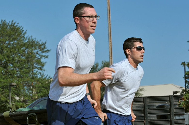 U.S. Air Force Capt. Ryan Scott, 20th Medical Operations Squadron physical therapist, left, and Capt. John Kauderman, 20th Aerospace Medicine Squadron optometrist, carry a litter during a Warrior Day commander's challenge at Shaw Air Force Base, S.C., Sept. 29, 2017.