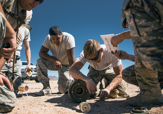 Senior Airman Jared Ball, 56th Civil Engineer Squadron explosive ordinance disposal team member, performs render safe procedures on a Mark 81 bomb at the Gila Bend Air Force Auxiliary Field in Gila Bend, Ariz., Sept. 21, 2017. The render safe procedure is the act of applying special EOD procedures, methods and tools to provide the interruption of functions or separations of essential components of unexploded ordnance to prevent an unacceptable detonation. (U.S. Air Force photo/Airman 1st Class Alexander Cook)