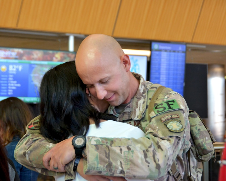 Reserve defenders from the 507th Air Refueling Wing Security Forces Squadron reunite with friends and family Oct. 1, 2017, at Will Rogers World Airport in Oklahoma City, following a six-month deployment to Afghanistan in support of Operation Freedom's Sentinel. The Reserve Citizen Airmen served at Kandahar Air Base, Afghanistan, where they assisted the Afghan Air Force in their fight against insurgents. The team of Reserve defenders was part of a Fly Away Security Team, which is made up of Security Forces Airmen who travel with aircraft to provide extra security around unsecured foreign airfields. (U.S. Air Force photo/Tech. Sgt. Samantha Mathison)