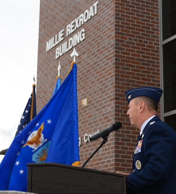 "Col. John Edwards, 28th Bomb Wing commander, provides remarks on Ola ""Millie"" Rexroat during a building dedication in her honor at Ellsworth Air Force Base, S.D., Oct. 2, 2017. Capt. Ola ""Millie"" Rexroat, the only recorded Native American member of the Women Airforce Service Pilot corps in 1944, will now have her legacy live on through the airfield operations building. (U.S. Air Force Photo by Airman 1st Class Donald C. Knechtel)"
