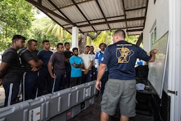U.S. Navy Electronics Technician 1st Class Christian Newsom, assigned to Explosive Ordnance Disposal Mobile Unit (EODMU) 1, explains the use of an unmanned underwater vehicle (UUV) to Sri Lankan Navy personnel during Cooperation Afloat Readiness and Training (CARAT) Sri Lanka 2017 in Trincomalee, Sri Lanka, Oct. 2, 2017. CARAT is a series of annual maritime exercises between the U.S. Navy, U.S. Marine Corps and the armed forces of partner nations to include Bangladesh, Brunei, Indonesia, Malaysia, Sri Lanka, Singapore, Thailand and Timor-Leste.