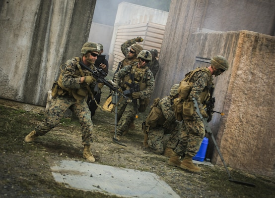 U.S. Marines with 2nd Battalion, 3rd Marines, clear for secondary improvised explosive devices during urban operations training at Marine Training Area Bellows, Hawaii, Sept. 28, 2017. Urban Operations is an opportunity to demonstrate the U.S. Marine Corps capability to component commanders and the Chief of Staff of the Armed Forces of the Philippines. (U.S. Marine Corps photo by Sgt. Wesley Timm)