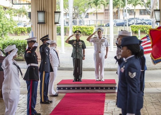 CAMP H.M. SMITH, Hawaii (Sept. 28, 2018) — Adm. Harry Harris, Commander of U.S. Pacific Command (PACOM), and Gen. Eduardo Año, Chief of Staff for the Armed Forces of the Philippines, are welcomed at PACOM headquarters during an honors ceremony. During Año's two-day visit to PACOM, he and Harris will meet to discuss changes to the Mutual Defense Board and Security Engagement Board. The Mutual Defense Board provides direct liaison and consultation on military matters of mutual concern to develop and improve both countries' common defense. The Security Engagement Board provides the framework and mechanism for continuing liaison and consultation on non-traditional threats to security such as terrorism, transnational crimes, maritime security, and natural and man-made disasters. (U.S. Navy photo by Mass Communication Specialist 2nd Class James Mullen/Released)