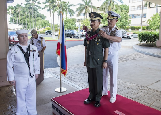 CAMP H.M. SMITH, Hawaii (Sept. 28, 2018)—Adm. Harry Harris, Commander of U.S. Pacific Command (PACOM), presents the Legion of Merit award to Gen. Eduardo Año, Chief of Staff for the Armed Forces of the Philippines, for exceptionally meritorious conduct during an honor ceremony at PACOM headquarters. During Año's two-day visit to PACOM, he and Harris will meet to discuss changes to the Mutual Defense Board and Security Engagement Board. The Mutual Defense Board provides direct liaison and consultation on military matters of mutual concern to develop and improve both countries' common defense. The Security Engagement Board provides the framework and mechanism for continuing liaison and consultation on non-traditional threats to security such as terrorism, transnational crimes, maritime security, and natural and man-made disasters. (U.S. Navy photo by Mass Communication Specialist 2nd Class James Mullen/Released)