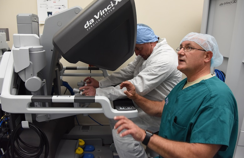 Maj. Scott Thallemer, perioperative nurse and robotics coordinator with the Institute for Defense Robotic Surgical Education (InDoRSE), trains Maj. Gen. Timothy Leahy, 2nd Air Force commander, on the da Vinci X surgical system used in robotics surgery at the Keesler Medical Center, Sept. 26, 2017, on Keesler Air Force Base, Miss. InDoRSE is working with the Air Force Research Lab to understand trust between surgical teams and the robot in order to improve on the training program. Trust is a key factor in determining proper use of such innovative technology as surgical robots. (U.S. Air Force photo by Kemberly Groue)