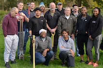 U.S. Air Force Team Mildenhall Airmen pose for a photograph with residents of Middlefield Manor in Barton Mills, England, Oct. 2, 2017.  Middlefield Manor is a care home for individuals who are autistic. Airmen volunteered their time by chopping wood, cutting reeds and building a boat landing dock. (U.S. Air Force photo by Senior Airman Christine Groening)
