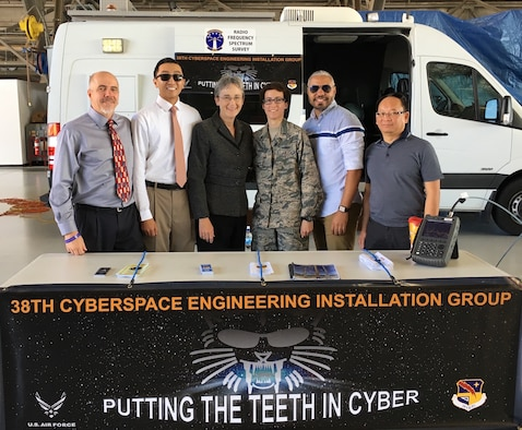 Secretary of the Air Force, Honorable Heather Wilson, poses with personnel from the 38th Cyberspace Engineering and Implementation Group during the Andrews AFB Airshow, Md, 15 Sep 2017.