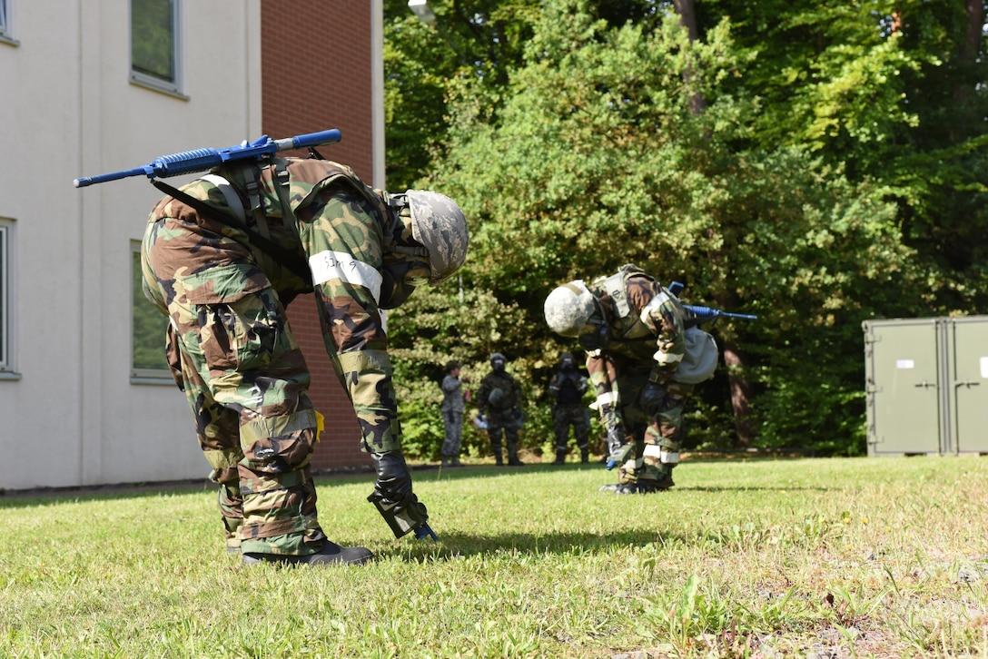 Emergency management specialists practice chemical warfare tasks during a simulated attack at the Silver Flag training site at Ramstein Air Base, Germany, Aug. 9, 2017. he training was part of an exercise that allowed Oklahoma Air National Guardsmen from the 137th Special Operations Wing, Will Rogers Air National Guard Base, Oklahoma City, and the 138th Fighter Wing, Tulsa Air National Guard Base, Tulsa, Oklahoma, to integrate different career fields and units for a realistic contingency environment.(U.S. Air National Guard photo by Senior Airman Caitlin G. Carnes/Released)