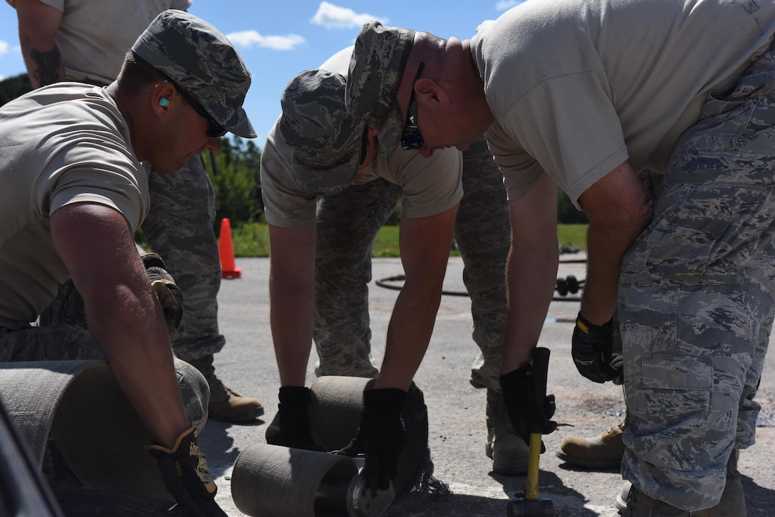 Electrical power production craftsmen from the 138th Fighter Wing from the Tulsa Air National Guard Base in Tulsa, Oklahoma and 137th Special Operations Wing from Will Rogers Air National Guard Base in Oklahoma City install components for a mobile aircraft arresting system at the Silver Flag training site at Ramstein Air Base, Germany, Aug. 7, 2017. The training was part of an exercise that allowed Oklahoma Air National Guardsmen from the 137th Special Operations Wing, Will Rogers Air National Guard Base, Oklahoma City, and the 138th Fighter Wing, Tulsa Air National Guard Base, Tulsa, Oklahoma, to integrate different career fields and units for a realistic contingency environment. (U.S. Air National Guard photo by Senior Airman Caitlin G. Carnes/Released)