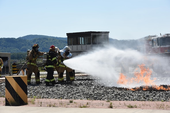 Air National Guard firefighters practice combating aircraft fires at the Silver Flag training site at Ramstein Air Base, Germany, Aug. 8, 2017. The training was part of an exercise that allowed Oklahoma Air National Guardsmen from the 137th Special Oeperations Wing, Will Rogers Air National Guard Base, Oklahoma City, and the 138th Fighter Wing, Tulsa Air National Guard Base, Tulsa, Oklahoma, to integrate with different career fields and units for a realistic contingency environment. (U.S. Air National Guard photo by Capt. Micah D. Campbell/Released)