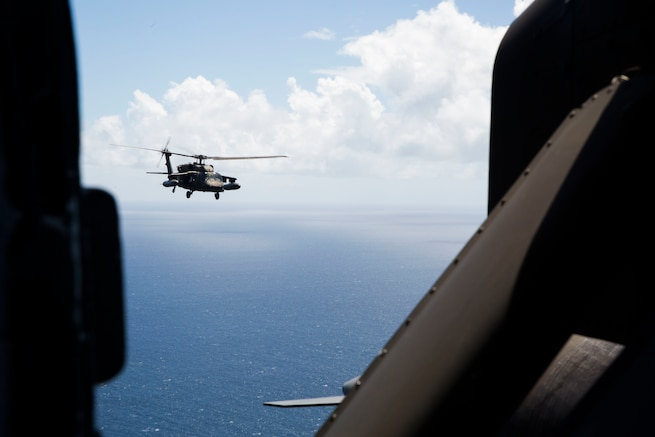 A U.S. Army UH-60 Black Hawk helicopter flies over the Caribbean Sea