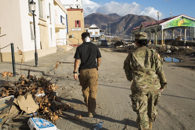 Soldiers head to a meeting with the U.S. Agency for International Development to discuss air operations, Roseau, Dominica.