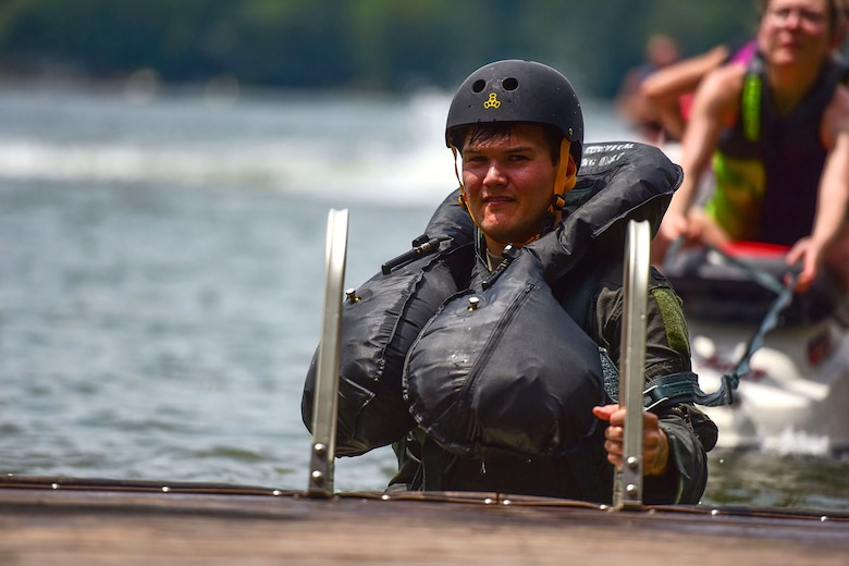 U.S. Air Force Capt. Cody Main, a pilot assigned to the 157th Fighter Squadron, prepares to participate in the back drag exercises during water refresher training conducted in Lake Murray, located in Chapin, S.C., Aug. 13, 2017. The mandatory bi-annual training assesses the pilot's ability to combat scenarios that may take place should they have to eject or bailout of the aircraft over water. (U.S. Air National Guard photo by Senior Airman Megan Floyd)