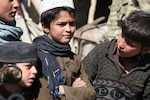Local boys observe activity within village of Sharmai, Paktika Province, Afghanistan, February 18, 2013, as Human Terrain Teams speak with locals
