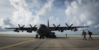 Loadmasters with the 15th Special Operations Squadron walk to an MC-130H Combat Talon II at Barbados