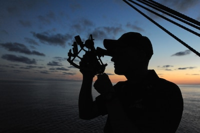 ATLANTIC OCEAN - A U.S. Coast Guard Academy officer candidate practices navigating using the stars and a sextant during an evening training session aboard United States Coast Guard Barque Eagle Sept. 13, 2012. Officer candidates spend two weeks aboard the Eagle during their training to further develop their seamanship, teamwork and leadership skills. (U.S. Coast Guard photo by Petty Officer 1st Class Lauren Jorgensen)