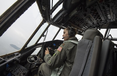 U.S. Air Force Reserve Maj. Elisa Klitzke, a pilot with the 731st Airlift Squadron, pilots a C-130 Hercules during this years Central Accord exercise in Libreville, Gabon on June 15, 2016. U.S. Army Africa's exercise Central Accord 2016 is an annual, combined, joint military exercise that brings together partner nations to practice and demonstrate proficiency in conducting peacekeeping operations. (DoD News photo by TSgt Brian Kimball)