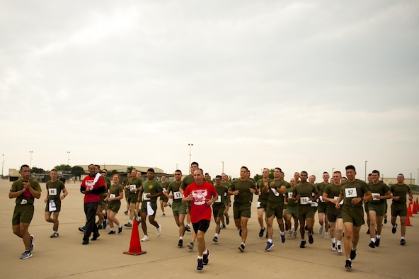 U.S. Air Force Lt. Col. Scott Cline, 312th Training Squadron commander, finishes the Blood, Sweat and Stairs event to the rally of volunteers who participated in the event at the Louis F. Garland Department of Defense Fire Academy on Goodfellow Air Force Base, Texas, Sept. 30, 2017. Cline went last as a non-competitor. (U.S. Air Force photo by Senior Airman Scott Jackson/Released)