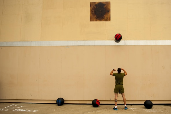 U.S. Marine Corps Pfc. Matthew Buenrostro, 312th Training Squadron trainee, performs a wall-ball exercise during the fourth annual Blood, Sweat and Stairs event at the Louis F. Garland Department of Defense Fire Academy on Goodfellow Air Force Base, Texas, Sept. 30, 2017. Blood, Sweat and Stairs is a circuit event comprised of numerous exercises spread out across the academy's. (U.S. Air Force photo by Senior Airman Scott Jackson/Released)