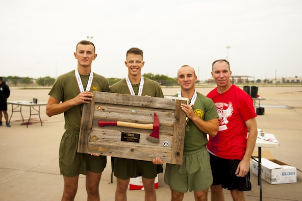 U.S. Marine Corps Lance Cpl. Zane Reece, Pfc. Christian Gender and Pfc. Tyler Mogul, 312th Training Squadron trainees, receive the first place plaque from U.S. Air Force Lt. Col. Scott Cline, 312th TRS commander, for winning the fourth annual Blood, Sweat and Stairs event at the Louis F. Garland Department of Defense Fire Academy on Goodfellow Air Force Base, Texas, Sept. 30, 2017. Each person competed on a team of three; the fastest won the event. (U.S. Air Force photo by Senior Airman Scott Jackson/Released)