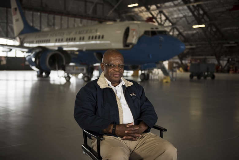 Retired Chief Master Sgt. Robert Brown poses for a photo in front of an executive aircraft on Joint Base Andrews, Md., for the Veterans in Blue project.