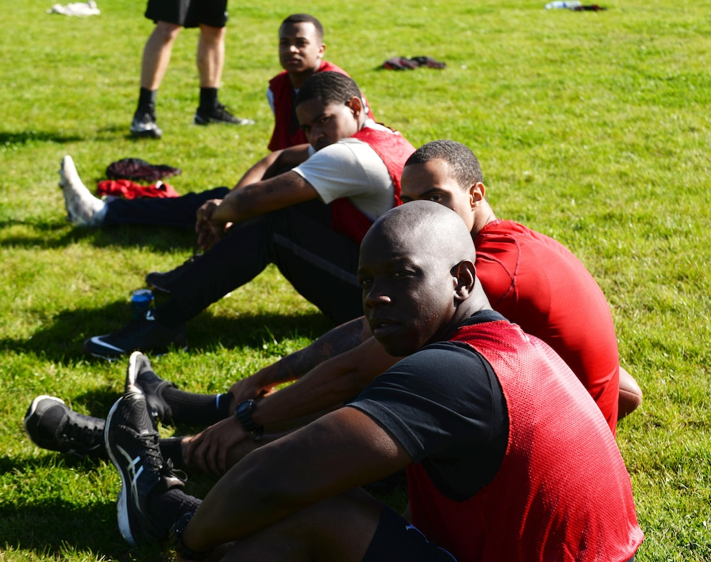Airmen from the 48th Civil Engineer Squadron Fire Department take a break from a soccer game during the Battle of the Badges, Sept. 30, 2017, on RAF Mildenhall, England. The Battle of the Badges was initiated to build camaraderie between the first responders. The 100th Civil Engineer Squadron hosted this year's competition. (U.S. Air Force photo by Airman 1st Class Alexandria Lee)