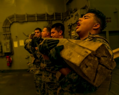U.S. Marines with the 15th Marine Expeditionary Unit's Logistics Combat Element conduct physical training as part of their combat conditioning portion during a Marine Corps Martial Arts Program brown belt course held aboard the amphibious dock landing ship USS Pearl Harbor (LSD 52) in the 5th Fleet area of operations Sept. 29, 2017. The 15th Marine Expeditionary Unit was embarked on the America Amphibious Ready Group and is deployed to maintain regional security in the U.S. 5th Fleet area of operations. (U.S. Marine Corps photo by Cpl. F. Cordoba)