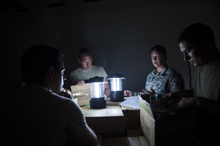 U.S. Army Capt. Beth Carriere, right, a physician assistant assigned to the Vermont National Guard's Medical Detachment, Task Force Bravo, briefs her team on how to organize the donated medications from various organizations at St. Thomas, Virgin Islands, Sept. 28, 2017.