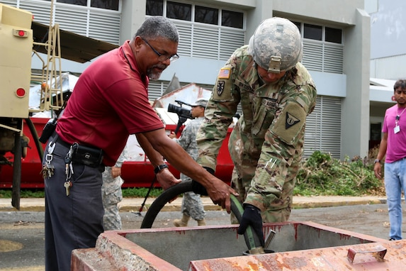 Soldier fills hospital generator with diesel fuel