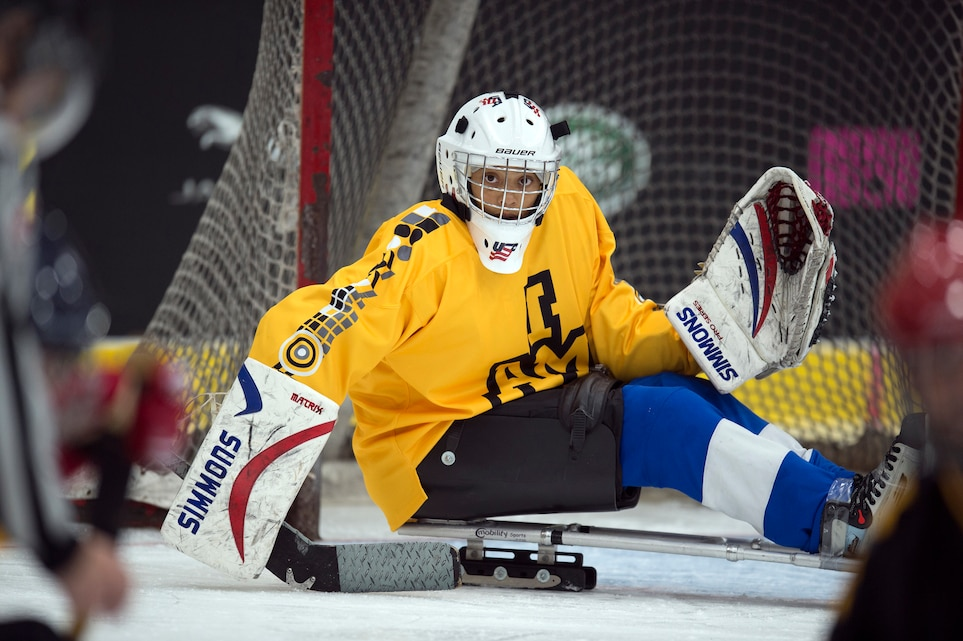 Marine Corps veteran Gabby Graves-Wake makes a save during a sled-hockey exhibition match at the 2017 Invictus Games.