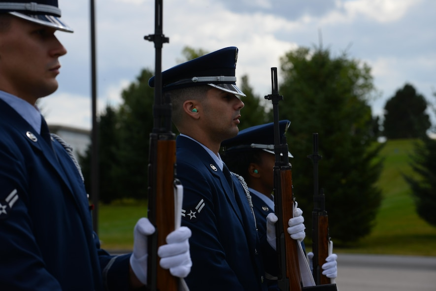 Airman 1st Class Kevin Negron, a fuels specialist assigned to the 28th Maintenance Squadron, salutes during the playing of Taps at Black Hills National Cemetery in Sturgis, S.D., Sept. 26, 2017. Ceremonial guardsmen serve in the Ellsworth Air Force Base, S.D., honor guard for one year with six months active and six months inactive. (U.S. Air Force photo by Airman Nicolas Z. Erwin)