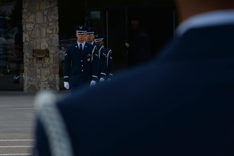 Airmen from Ellsworth Air Force Base, S.D., march to the firing line to perform military honors during a funeral at Black Hills National Cemetery in Sturgis, S.D., Sept. 26, 2017. Following the flag folding sequence, three members of the detail will depart to the firing line to fire three volleys before Taps plays. (U.S. Air Force photo by Airman Nicolas Z. Erwin)