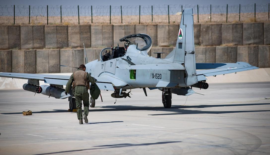 An Afghan A-29 pilot walks toward his aircraft at Kandahar Airfield, Afghanistan.