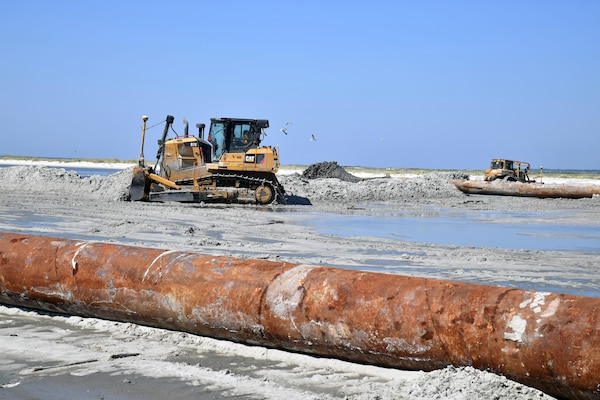 Bulldozers spread sand on Cat Island, Miss., Sept. 29. The island has nearly been restored to its 1990's shoreline, reducing hurricane risks to Mississippi and boosting the natural habitat for birds and turtles. The shoreline restoration is expected to conclude in mid-October with sand fencing and dune vegetation to be installed by May of 2018.
