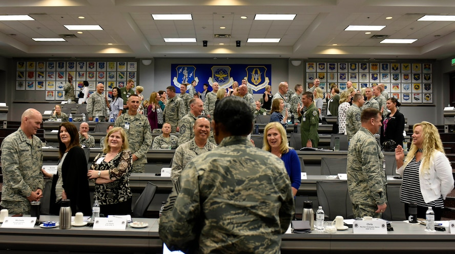 Chief Master Sgt. Shelina Frey, Air Mobility Command command chief watches as spouses read an oath to serve during AMC's fall Phoenix Rally Sept. 27 at Scott Air Force Base, Ill.