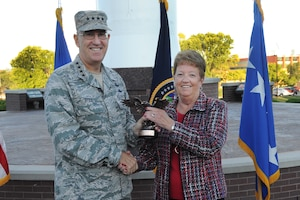 Peggy J. Corpman, human resources assistant, receives the Air Force A1 (Manpower and Personnel Directorate) Technician of the Year award for 2016 from U.S. Air Force Gen. John Hyten, commander of U.S. Strategic Command, during an awards ceremony at USSTRATCOM headquarters at Offutt Air Force Base, Neb., Sept. 28, 2017.