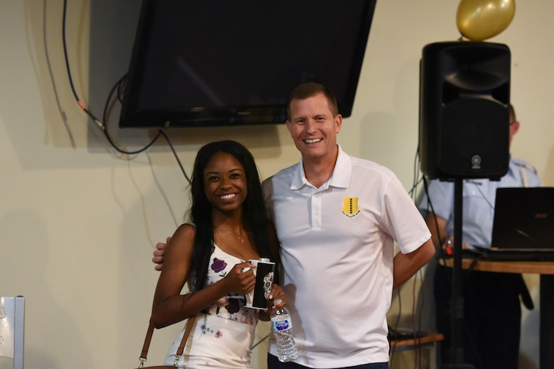 """U.S. Air Force Airman Diondra Watson, 315th Training Squadron trainee, receives the second place prize from Col. Jeffrey Sorrell, 17th Training Wing vice commander, during the Talent Show at the Crossroads on Goodfellow Air Force Base, Texas, Sept. 29, 2017. Diondra sang """"I Have Nothing"""" by Whitney Houston. (U.S. Air Force photo by Airman Zachary Chapman/Released)"""