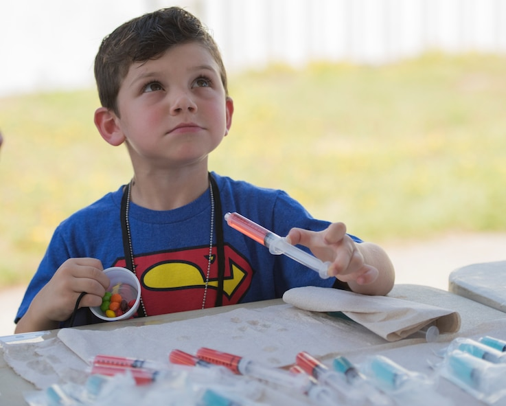 More than 470 kids participated in Operation Hero. The event was set up to show them the process their parents go through before they leave home.
