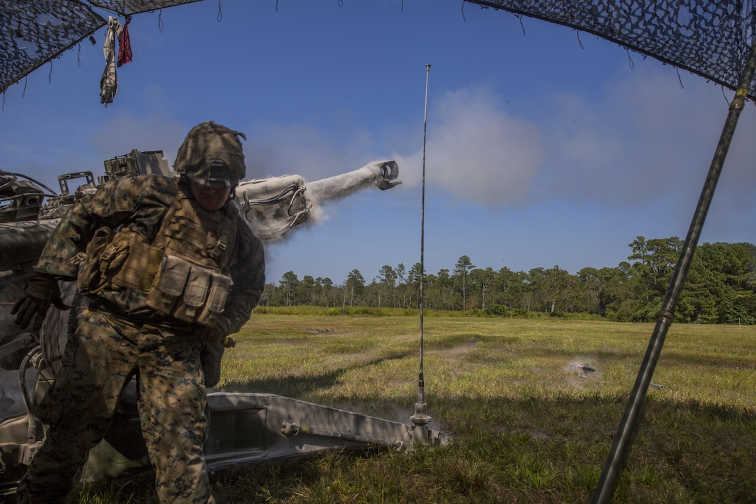 A Marine pulls the cord to fire an M777 howitzer during a Marine Corps Combat Readiness Evaluation at Camp Lejeune, N.C., Sept. 28, 2017. The Marines conducted the MCCRE to maintain readiness for future operations. The Marine is with 1st Battalion, 10th Marine Regiment. (U.S. Marine Corps photo by Lance Cpl. Taylor W. Cooper)