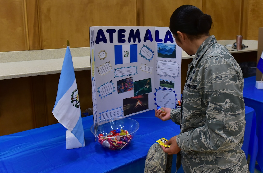 Capt. Christina Salinas, 314th Maintenance Squadron officer in charge of maintenance operations, reads about the history of Guatemala at the Hispanic Heritage Info Fair Sept. 29, 2017, at Walter's Community Support Center on Little Rock Air Force Base, Ark. There were booths featuring 20 different Hispanic countries. (U.S. Air Force photo by Airman Rhett Isbell)