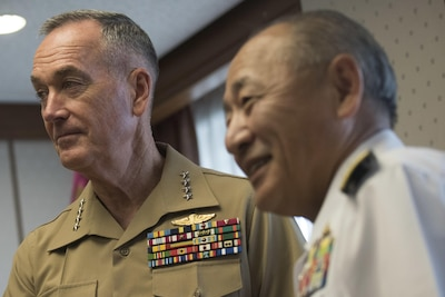 Marine Corps Gen. Joseph F. Dunford Jr., chairman of the Joint Chiefs of Staff, meets with Japan Self-Defense Force Adm. Katsutoshi Kawano, Chief of Staff, Joint Staff, at the Ministry of Defense in Tokyo, Aug. 18, 2017. (DOD photo by U.S. Navy Petty Officer 1st Class Dominique A. Pineiro)