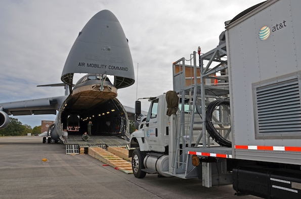 An AT&T communications vehicle is directed onto a C-5M Super Galaxy at Dobbins Air Force Reserve Base, Ga., Oct. 3, 2017. The vehicles were flown to Puerto Rico to assist in the restoration of communications for the island. (U.S. Air Force photo by Tech. Sgt. Kelly Goonan)