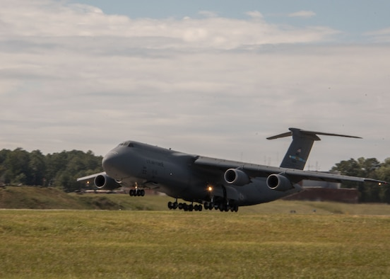 A C-5M Super Galaxy from Dover Air Force Base, Del. takes off at Dobbins Air Reserve Base, Ga. Oct. 2, 2017. The plane took vital communication equipment as well as AT&T Network Disaster Recovery Team members to provide communication support to Puerto Rico in the wake of Hurricane Maria's destruction. (U.S. Air Force photo/Staff Sgt. Andrew Park)