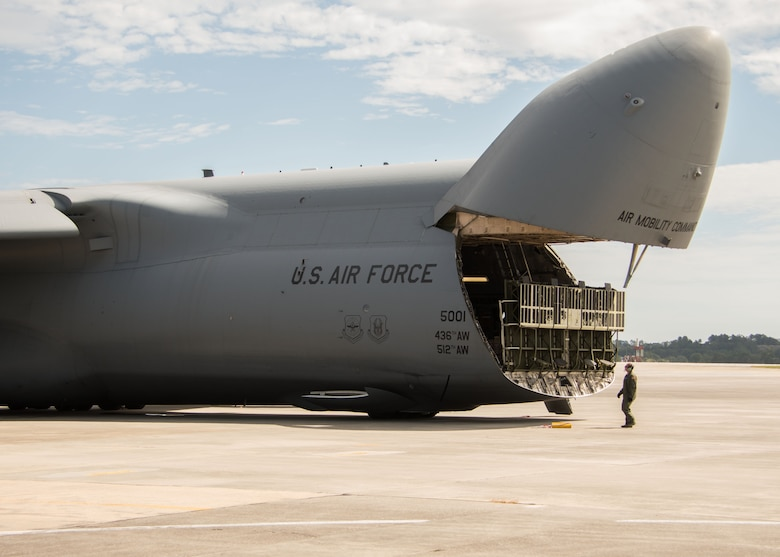 An aircrew member from Dover Air Force Base, Del. watches as a cargo bay door closes on a C-5M Super Galaxy at Dobbins Air Reserve Base, Ga. Oct. 2, 2017. The plane then departed to bring vital communication equipment to Puerto Rico, which was caught in the destructive path of Hurricane Maria. (U.S. Air Force photo/Staff Sgt. Andrew Park)