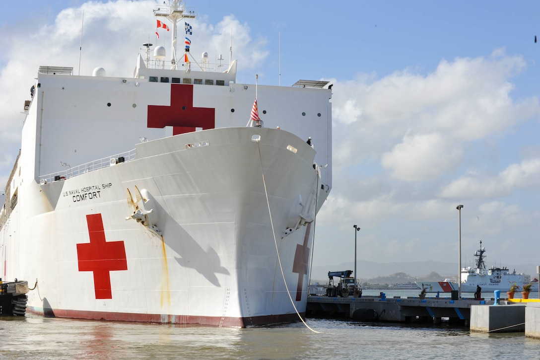 The USNS Comfort pulls up to the dock.