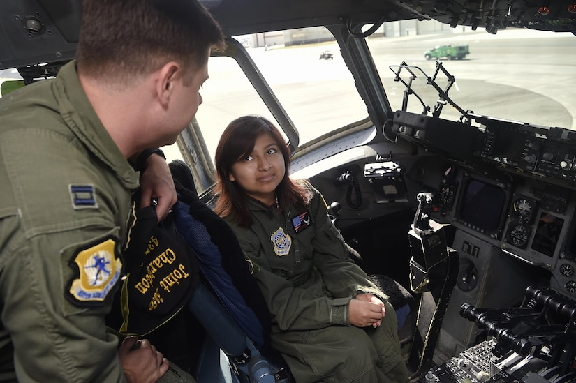 Sandrea Hershey, right, 14 years old, talks to Capt. Keane Carpenter, left, 437th Airlift Wing, during a C-17 Globemaster III tour as part of an Airman for a Day event here, Oct. 2, 2017. The event was hosted by the 628th Air Base Wing and 437th AW.  Hershey was diagnosed with cancer in 2015 and spent approximately 170 days in a hospital. Despite her diagnosis Hershey kept up with her school work and finished her final treatment last month. Sandrea, her mother Lori Hershey, and her friend Justin Pippin, also 14 years old, met 628th Security Forces Squadron Phoenix Raven members, observed a military working dog demonstration and tested their piloting skills in a C-17 flight simulator. (U.S. Air Force photo by Staff Sgt. Christopher Hubenthal)