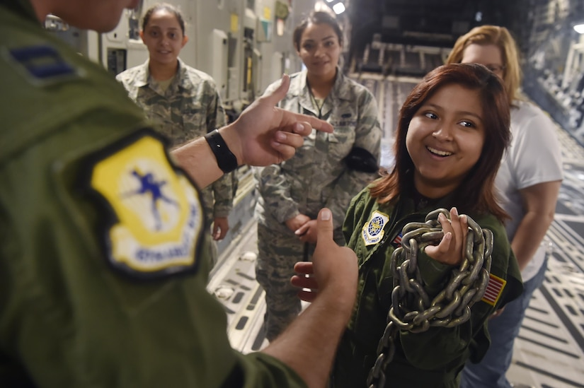 Sandrea Hershey, 14 years old, tours a C-17 Globemaster III alongside Airmen of the 437th Airlift Wing during an Airman for a Day event here, Oct. 2, 2017. The event was hosted by the 628th Air Base Wing and 437th AW.  Hershey was diagnosed with cancer in 2015 and spent approximately 170 days in a hospital. Despite her diagnosis Hershey kept up with her school work and finished her final treatment last month. Sandrea, her mother Lori Hershey, and her friend Justin Pippin, also 14 years old, met 628th Security Forces Squadron Phoenix Raven members, observed a military working dog demonstration and tested their piloting skills in a C-17 flight simulator. (U.S. Air Force photo by Staff Sgt. Christopher Hubenthal)