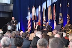 DIA Director Lt. Gen. Robert Ashley, Jr. addresses the crowd with Deputy Secretary of Defense Patrick Shanahan (back left), Director of National Intelligence Daniel Coats (back center) and former DIA Director Vincent Stewart (back right) looking on during the Change of Directorship Ceremony Oct. 3 at DIA Headquarters in Washington, D.C.