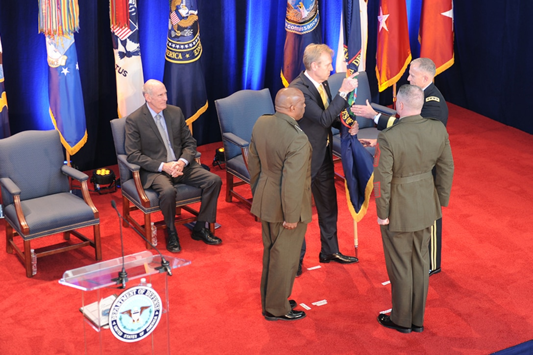 The Passing of The Colors between Former DIA Director,  Vincent R. Stewart, Deputy Secretary of Defense Patrick Shanhanan, DIA Director, LTG Robert P. Ashley, and MGySgt Scott H. Stalker during the Change of Command ceremony at DIA Headquarters Oct. 3, 2017 in Washington, D.C.