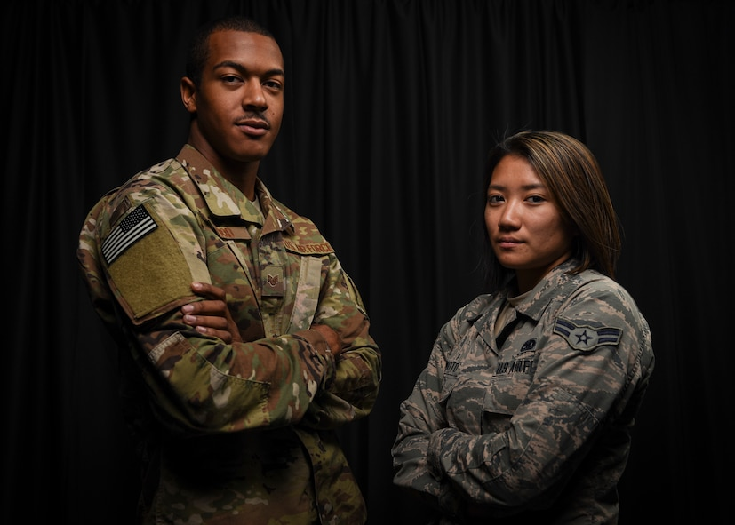 Staff Sgt. Dondre Wood and Airman 1st Class Korie Morimoto, 823rd Maintenance Squadron aircraft fuels systems maintainers, pose for a portrait at Nellis Air Force Base, Nev, Oct. 3, 2017. The Airmen's quick actions resulted in safely evacuating attendees during the Las Vegas shooting that occurred Oct. 1, 2017.